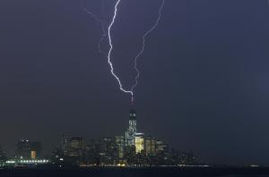 New York City, New York State, USA --- Two bolts of lightning hit the antenna on top of One World Trade Center in Lower Manhattan as an electrical storm moves over New York, May 23, 2014. --- Image by © Gary Hershorn/Corbis